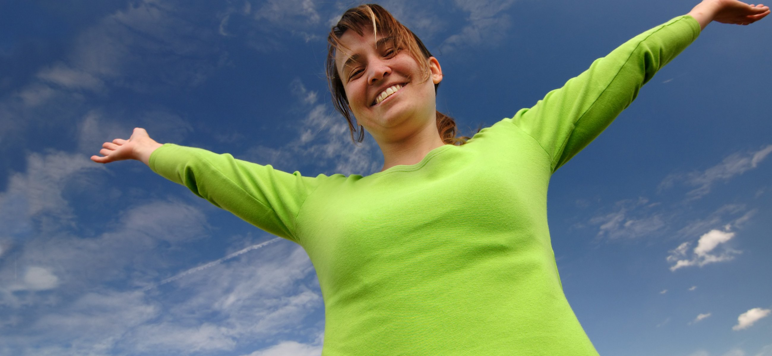 Happy lady with arms in air