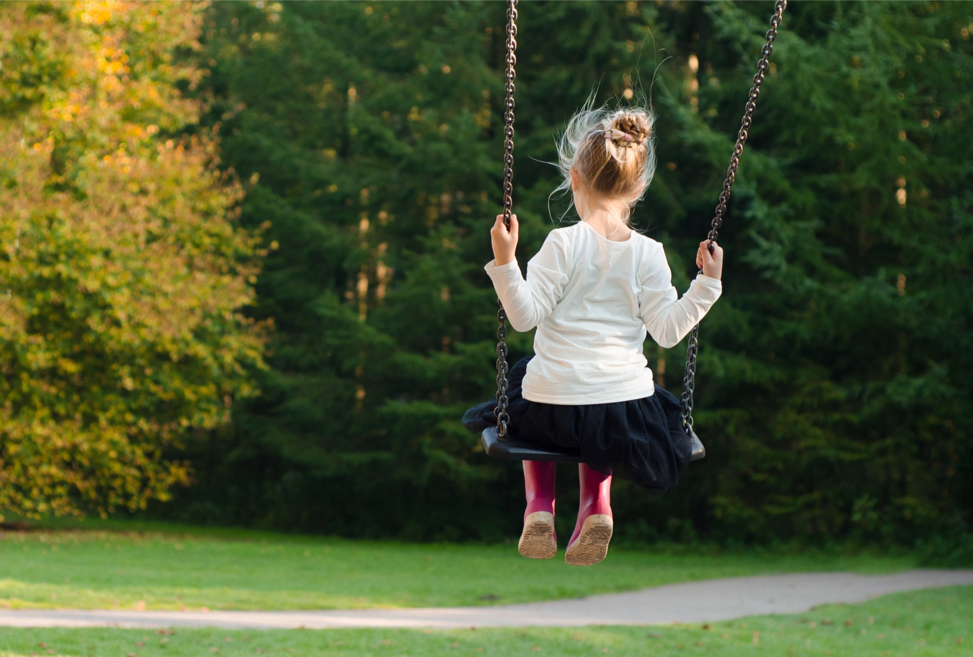 therapy pro kids child swinging on a swing with her back to the camera