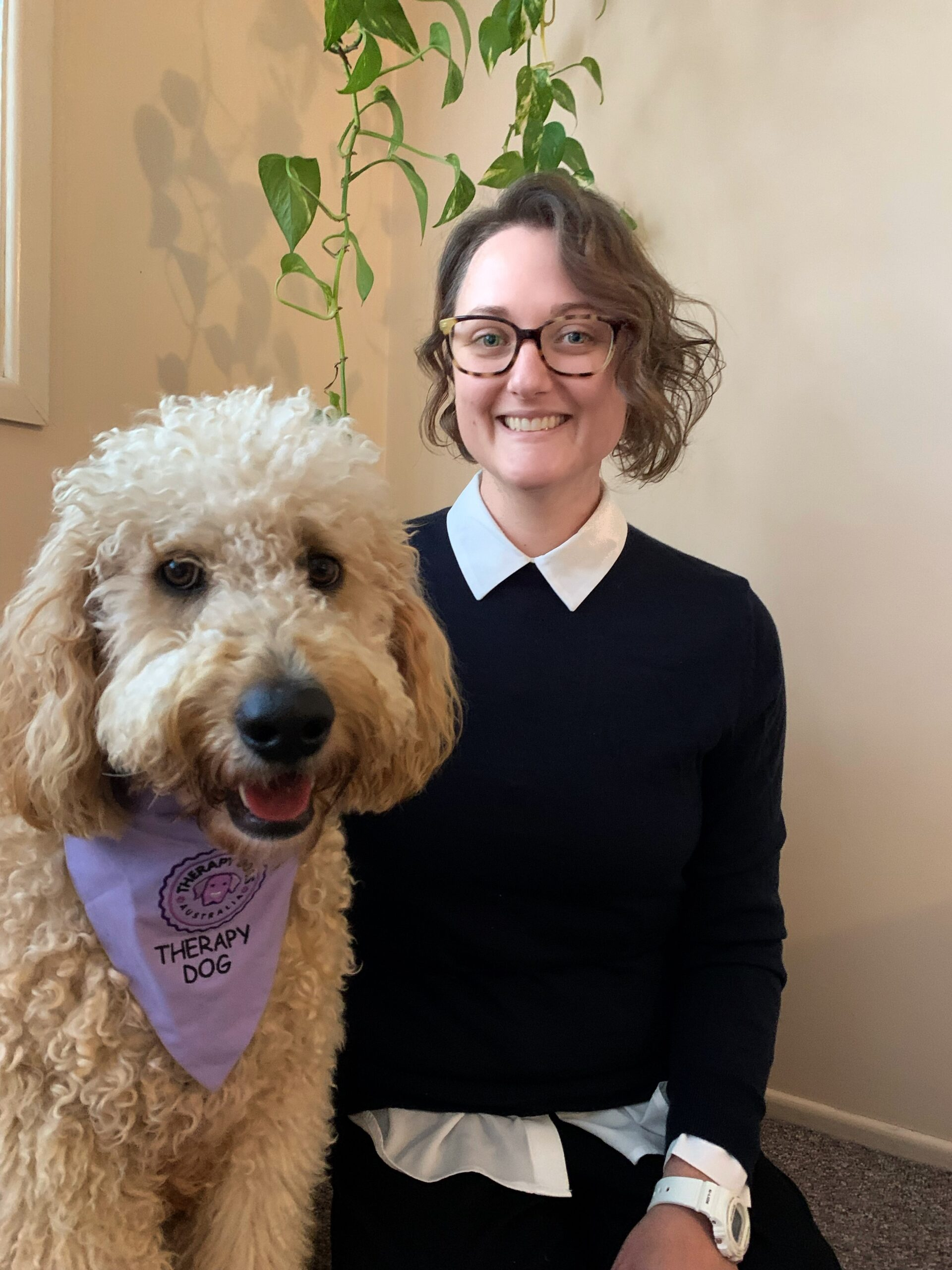 a therapy dog and their dog mum sit together they make a great working team